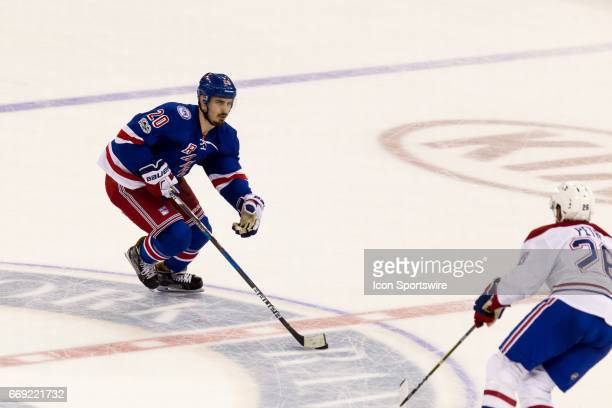 New York Rangers left wing Chris Kreider takes the puck across center ice during the second period of game 3 of the first round of the 2017 Stanley...