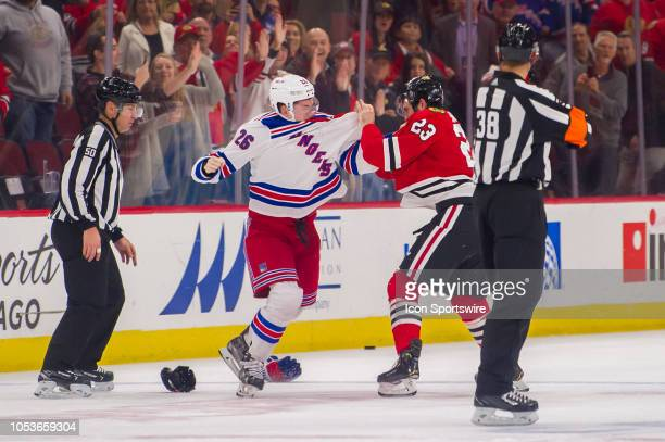 New York Rangers left wing Jimmy Vesey and Chicago Blackhawks defenseman Brandon Manning fight during a game between the New York Rangers and the...