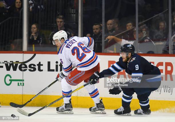 New York Rangers Left Wing Jimmy Vesey makes a pass as Winnipeg Jets Center Andrew Copp gives chase during a NHL game between the Winnipeg Jets and...