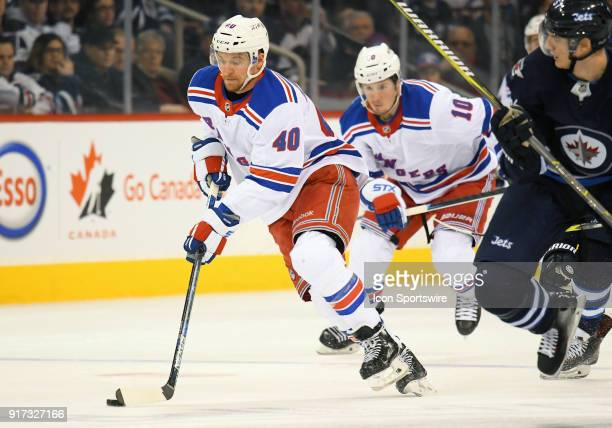 New York Rangers Left Wing Michael Grabner skates with the puck during a NHL game between the Winnipeg Jets and New York Rangers on February 11 2018...