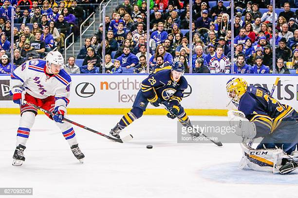 New York Rangers Left Wing Michael Grabner takes shot as Buffalo Sabres Goalie Anders Nilsson prepares to make save and Buffalo Sabres Defenseman...