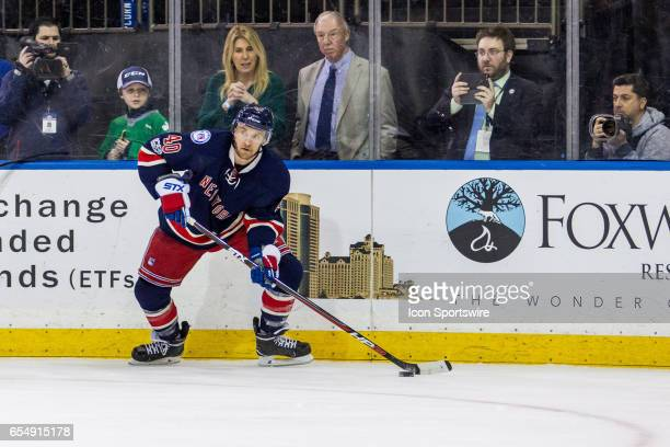 New York Rangers Left Wing Michael Grabner works along the boards during the third period of an Eastern Conference matchup between the Florida...