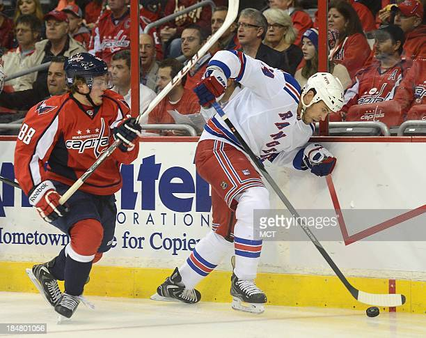 New York Rangers left wing Taylor Pyatt works the puck along the boards against Washington Capitals defenseman Nate Schmidt in the first period at...