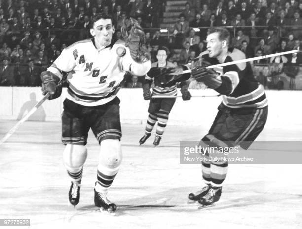 New York Rangers' Lou Fontinato fights for loose puck with Warren Godfrey during game against Boston Bruins