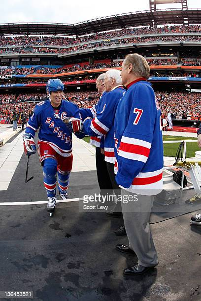 New York Rangers Mark Messier and ambassadors Harry Howell Ed Giacomin and Rod Gilbert and prior to the game against the Philadelphia Flyers at...