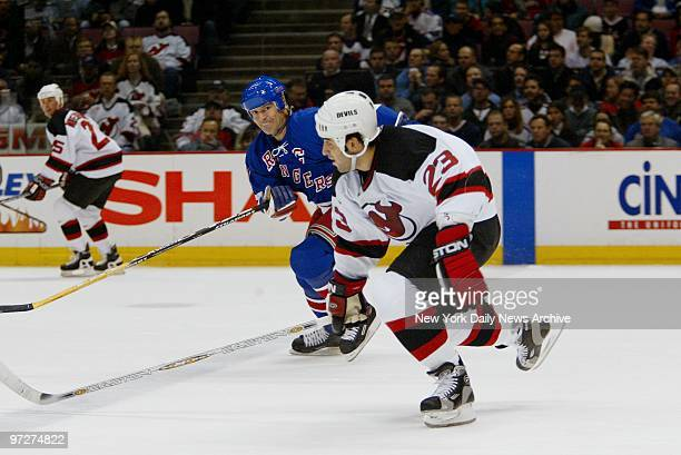 New York Rangers' Mark Messier gives chase to New Jersey Devils' Scott Gomez during action at Continental Airlines Arena The game ended in 44 tie in...