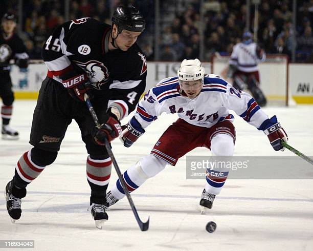 New York Rangers' Petr Prucha keeps an eye on Buffalo Sabres' Dmitri Kalinin during a game against the Rangers at the HSBC Arena in Buffalo, NY,...