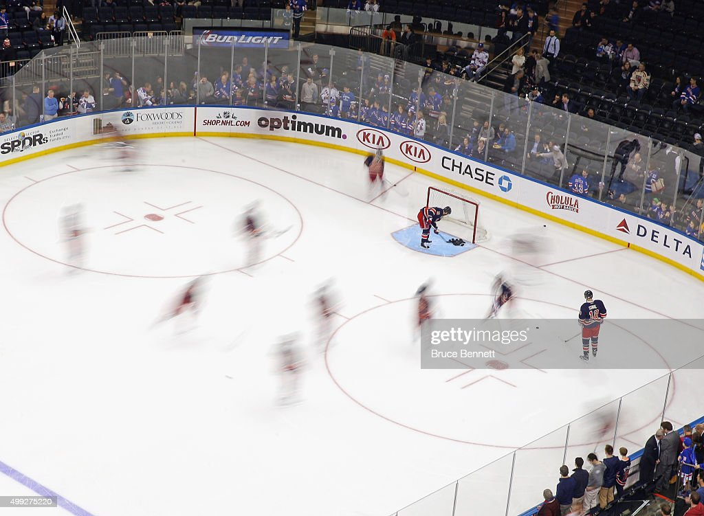 New York Rangers players skate in warmups prior to the game against the Philadelphia Flyers at Madison Square Garden on November 28, 2015 in New York City.