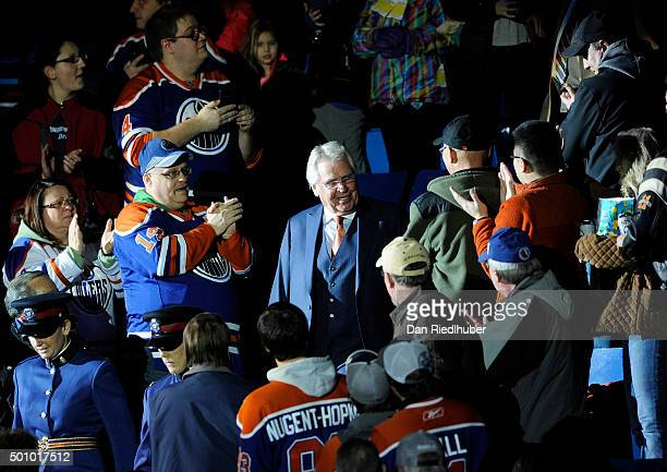 New York Rangers President Glen Sather walks down the steps to the ice where he was honoured by the Edmonton Oilers at Rexall Place on December 11...