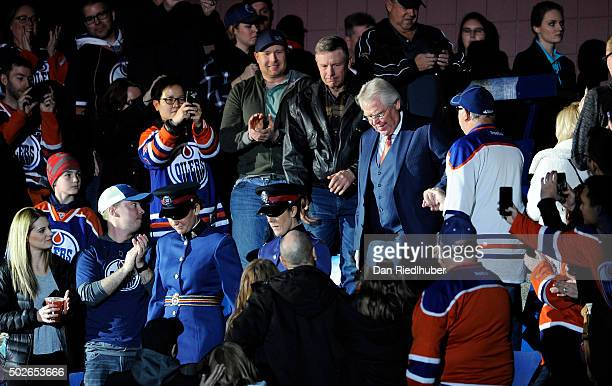 New York Rangers president Glen Sather walks through the crowd on his way to center ice where the Edmonton Oilers Hockey Club paid tribute to his...