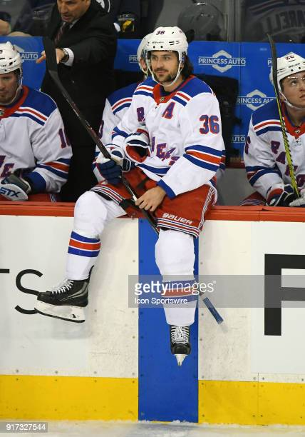 New York Rangers Right Wing Mats Zuccarello sits on the boards during a NHL game between the Winnipeg Jets and New York Rangers on February 11 2018...