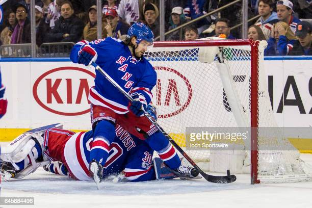 New York Rangers Right Wing Mats Zuccarello slaps the puck out of the net after a Columbus goal during the second period of a Metropolitan Divisional...