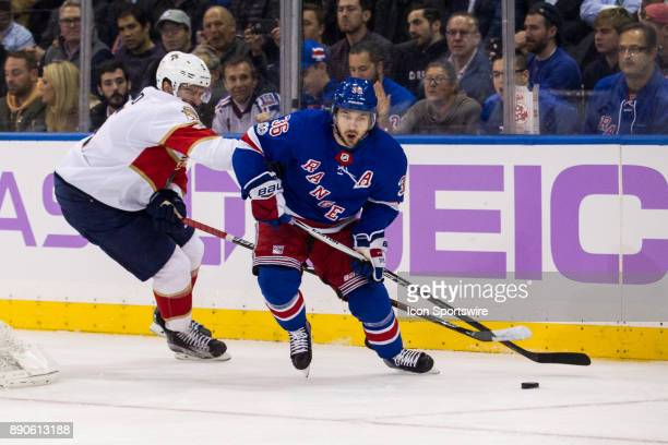 New York Rangers Right Wing Mats Zuccarello takes the puck out from behind the Panthers net during the first period of a regular season NHL game...