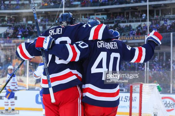 New York Rangers right wing Michael Grabner celebrates with New York Rangers defenseman Brady Skjei after he scores during the first period of the...