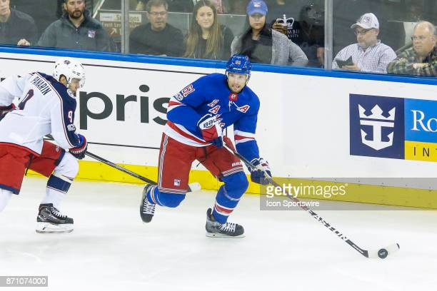 New York Rangers right wing Rick Nash looks to pass as Columbus Blue Jackets left wing Artemi Panarin closes in during the Columbus Blue Jackets and...