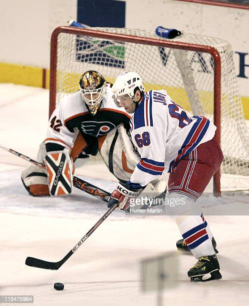 New York Rangers right winger Jaromir Jagr handles the puck in front of Philadelphia Flyers goalie Robert Esche at the Wachovia Center in...
