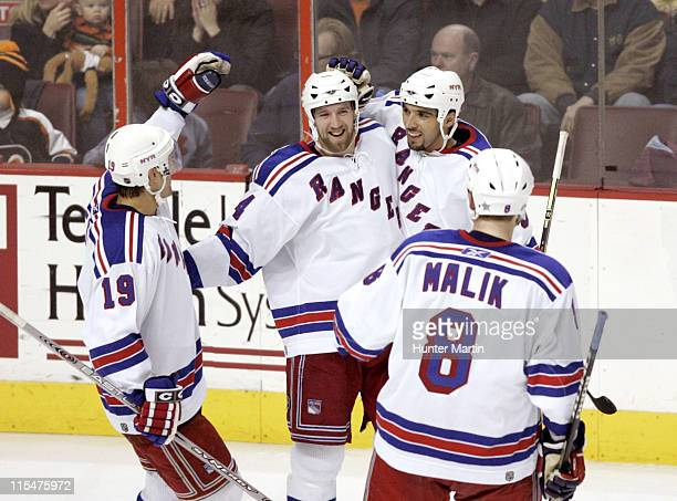 New York Rangers right winger Jason Ward is congratulated by teammates after scoring a goal at the Wachovia Center in Philadelphia Pennsylvania on...