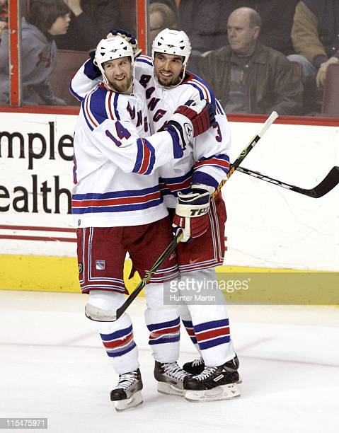 New York Rangers right winger Jason Ward is congratulated by teammate Michal Rozsival after scoring a goal at the Wachovia Center in Philadelphia...