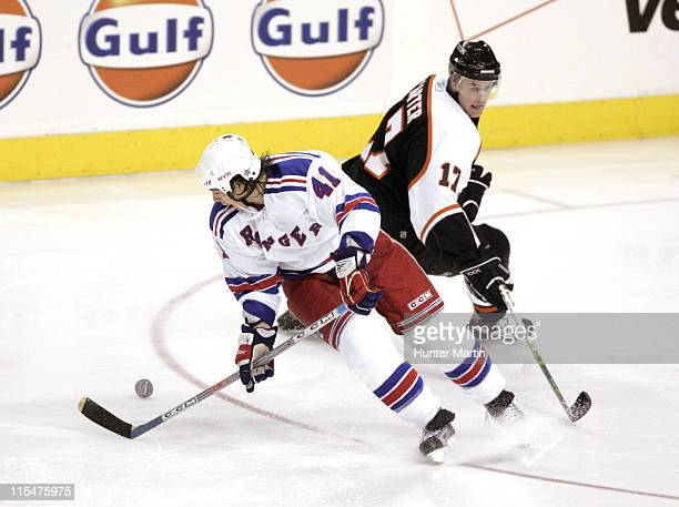 New York Rangers right winger Jed Ortmeyer puts a move on Philadelphia Flyers center Jeff Carter at the Wachovia Center in Philadelphia Pennsylvania...