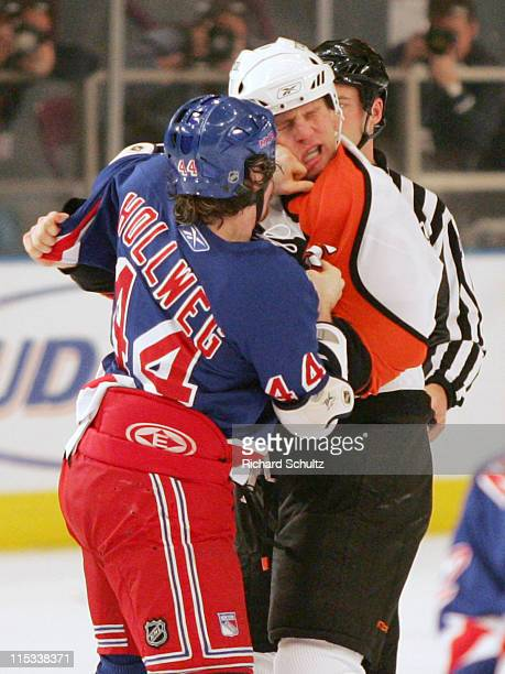 New York Rangers' Ryan Hollweg lands a left punch to the face of Philadelphia Flyers' Ben Eager during the first period at Madison Square Garden in...