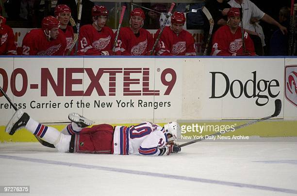 New York Rangers' Sandy McCarthy falls in front of the Detroit Red Wings bench Rangers lost 06 at Madison Square Garden