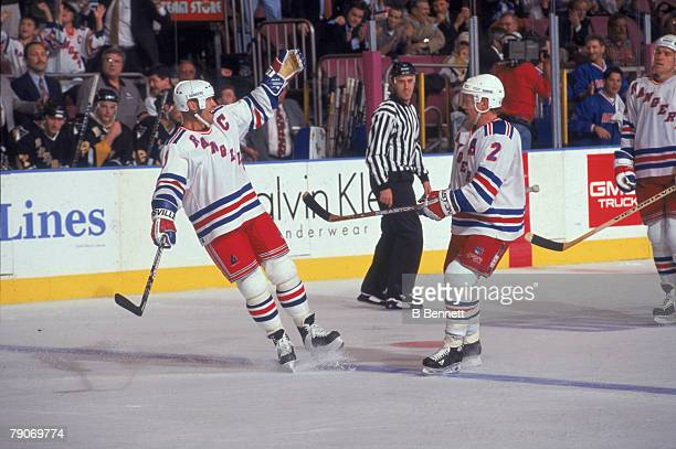 New York Rangers teammates Canadian Mark Messier and American Brian Leetch celebrate on the ice during a game 1990s or early 2000s