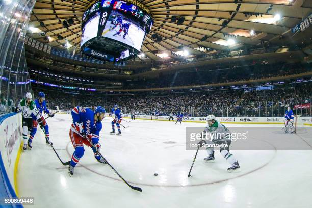 New York Rangers Winger Paul Carey and Dallas Stars Left Wing Remi Elie close in on lose puck during the Dallas Stars and New York Rangers NHL game...