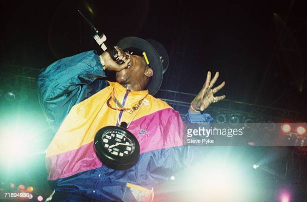 New York rapper Flavor Flav performing with hip hop group Public Enemy in Paris February 1992 He is wearing his trademark clock around his neck...