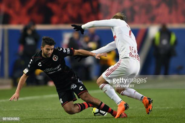 New York Red Bulls' Daniel Royer and Club Tijuana's Ignacio Malcorra vie for the ball during the Concacaf Champions League 2nd Leg Quarter-final...