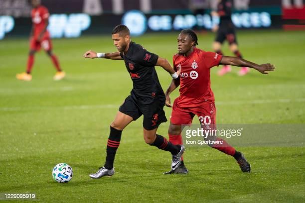 New York Red Bulls Defender Amro Tarek dribbles the ball with Toronto FC Forward Ayo Akinola defending during the second half of a Major League...