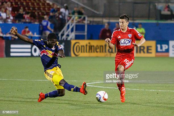 New York Red Bulls defender Kemar Lawrence slides to make a tackle on FC Dallas midfielder Mauro Diaz during the MLS match between the New York...