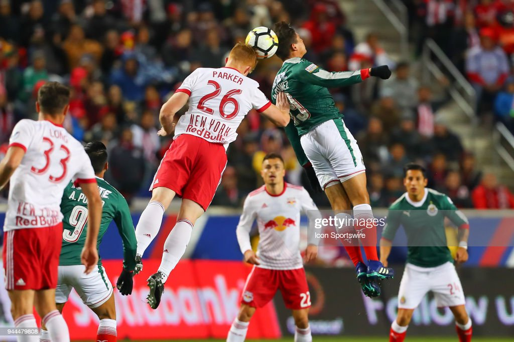 New York Red Bulls defender Tim Parker (26) battles Guadalajara forward José Godínez (89) during the first half of the CONCACAF Champions League game between Chivas de Guadalajara at NY Red Bulls on April 10, 2018, at Red Bull Arena in Harrison, NJ.