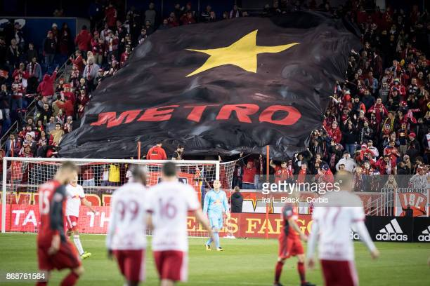 New York Red Bulls fans waving Metro flag after Daniel Royer of New York Red Bulls scored a goal during the Audi MLS Cup Playoff match between New...