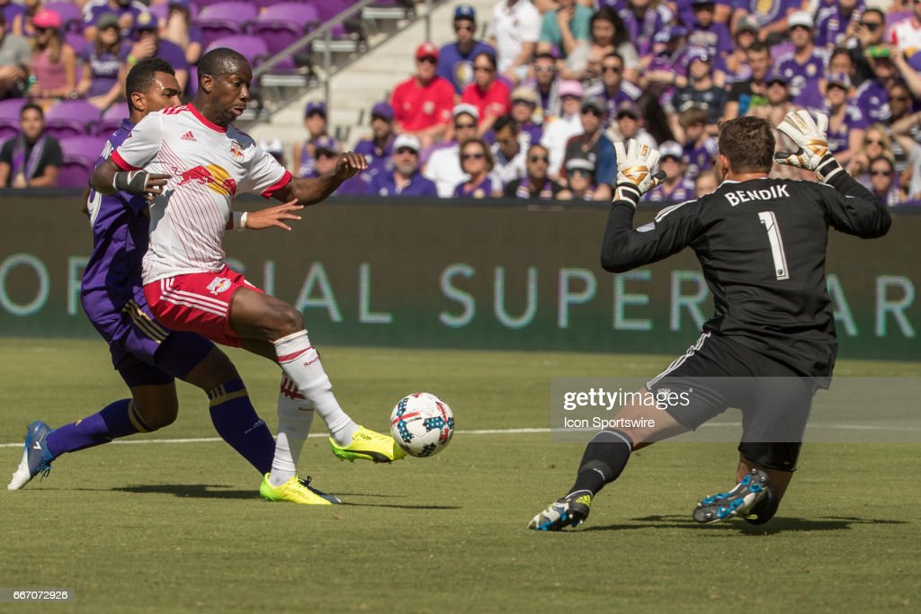 New York Red Bulls forward Bradley Wright-Phillips (99) attempts a goal kick but has it blocked by Orlando City SC goalkeeper Joseph Bendik (1) during the soccer match between the Orlando City Lions and the NY Red Bulls on April 9, 2017 at Orlando City Stadium in Orlando, FL.
