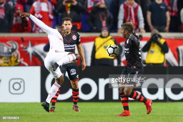 New York Red Bulls forward Bradley WrightPhillips battles for the ball against Tijuana forward Miller Bolanos during the second half of the CONCACAF...
