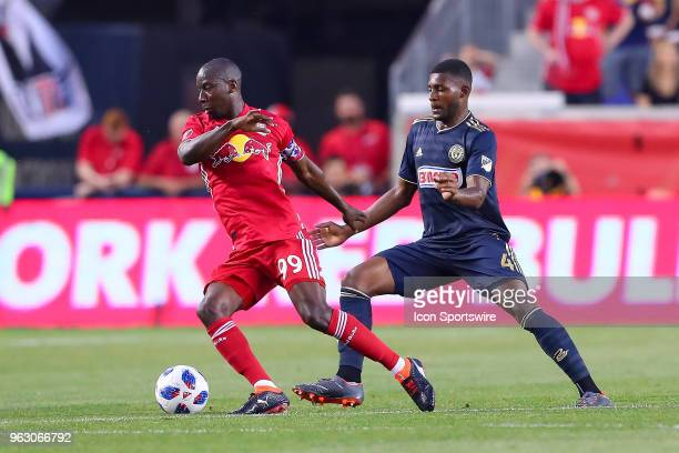 New York Red Bulls forward Bradley WrightPhillips battles Philadelphia Union defender Mark McKenzie during the second half of the Game between the...