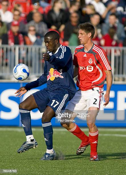 New York Red Bulls forward Josmer Altidore fends off defender Andrew Boyens during the match against the Toronto FC in Toronto, Ontario, Canada on...