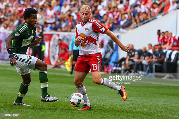New York Red Bulls forward Mike Grella tries to get around Portland Timbers defender Alvas Powell during the first half of the game between the New...
