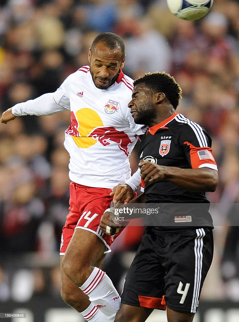 New York Red Bulls forward Thierry Henry (14) and D.C. United defender Brandon McDonald (4) battle for a head ball during first-half action in an MLS Eastern Conference semifinal at RFK Stadium in Washington, D.C., Saturday, November 3, 2012.