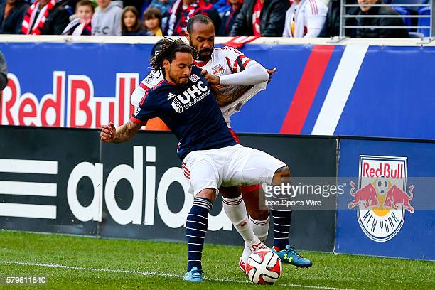 New York Red Bulls forward Thierry Henry battles New England Revolution midfielder Jermaine Jones during the first half of the MLS Eastern Conference...