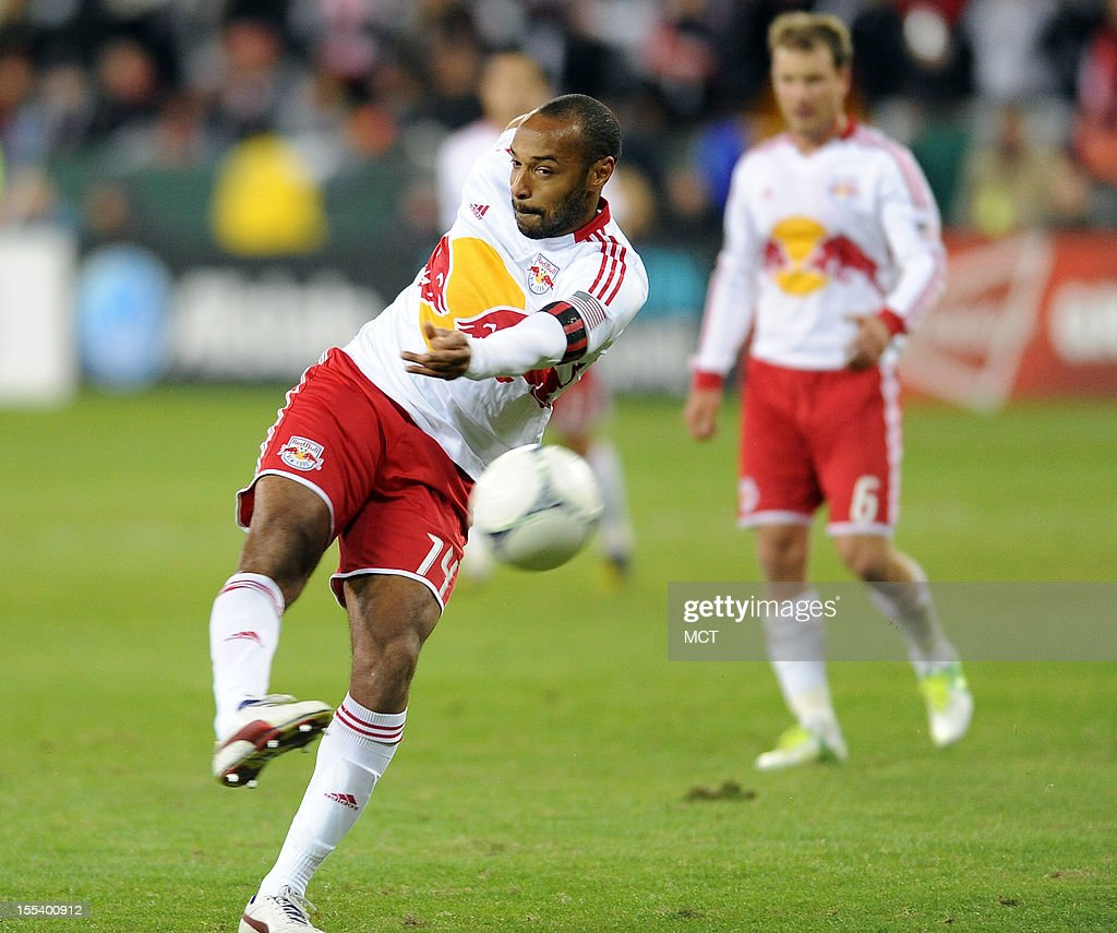 New York Red Bulls forward Thierry Henry (14) fires a shot on the D.C. United goal during first-half action in an MLS Eastern Conference semifinal at RFK Stadium in Washington, D.C., Saturday, November 3, 2012.