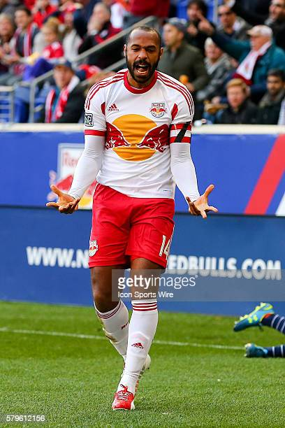New York Red Bulls forward Thierry Henry reacts after being called for a foul on New England Revolution midfielder Jermaine Jones during the first...