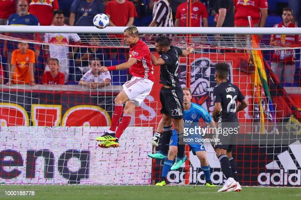 New York Red Bulls midfielder Aaron Long goes up for a head ball during the second half of the Major League Soccer game between Sporting Kansas City...