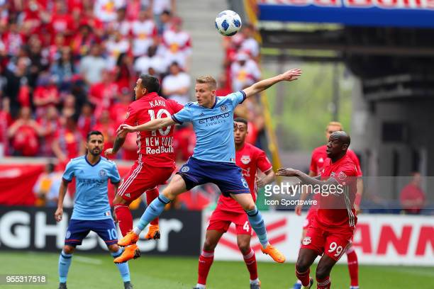 New York Red Bulls midfielder Alejandro Romero Gamarra battles New York City midfielder Alexander Ring for a head ball during the first half of the...
