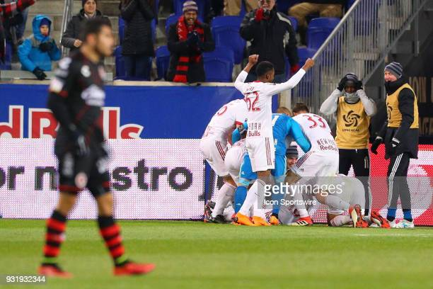 New York Red Bulls midfielder Alejandro Romero Gamarra celebrates with teammates after scoring during the second half of the CONCACAF Champions...