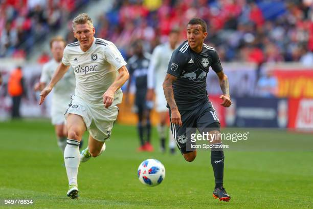 New York Red Bulls midfielder Alejandro Romero Gamarra runs past Chicago Fire midfielder Bastian Schweinsteiger during the first half of the Major...