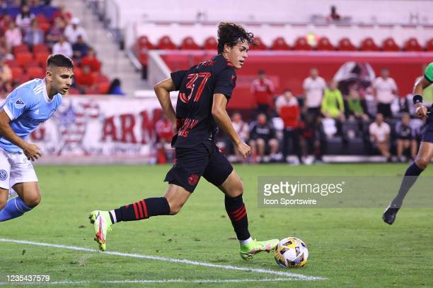 New York Red Bulls midfielder Caden Clark controls the ball during the second half of the Major League Soccer game between the New York Red Bulls and...