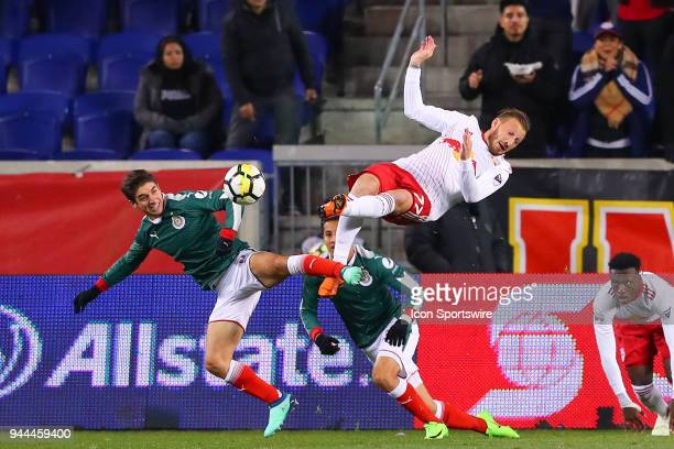 New York Red Bulls midfielder Daniel Royer battles Guadalajara forward Isaac Brizuela during the first half of the CONCACAF Champions League game...