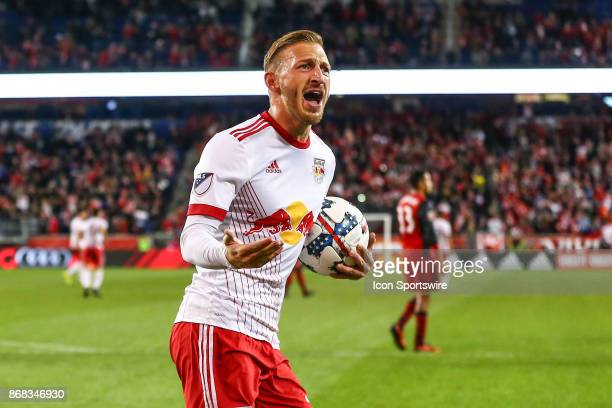 New York Red Bulls midfielder Daniel Royer celebrates after he scores on a penalty kick during the first half of the MLS Cup Playoff game between the...