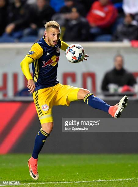 New York Red Bulls midfielder Daniel Royer looks to trap the ball with his foot during the MLS Cup Playoff match between the New York Red Bulls and...